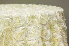 Rent ivory color rosette taffeta round tablecloth