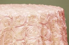 Rent baby pink color rosette taffeta round tablecloth